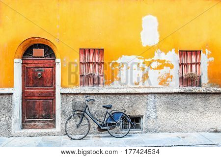 Classic bicycle standing near the old house Italy.
