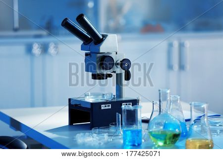 Microscope and test tubes in laboratory