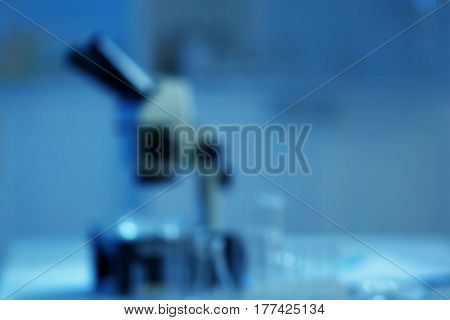 Blurred view of microscope in laboratory