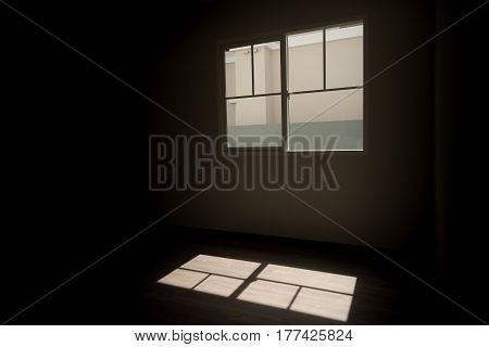 Light from windows shine on the floor in dark room.