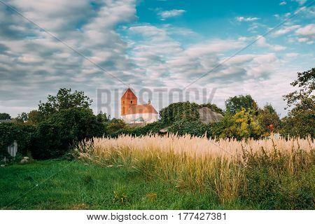 Mir, Belarus. Landscape Of Village Houses And Saint Nicolas Roman Catholic Church In Mir, Belarus. Famous Landmark.