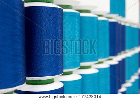 Closed up of various blue color thread reel background