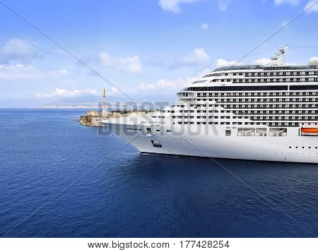 MESSINA, SICILY, ITALY - MAY 05, 2011: MSC Fantasia cruise ship sailing from port. MSC Fantasia is the largest cruise ship ever built for a European ship owner.