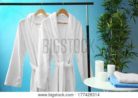 Bathrobes hanging on rack at spa salon