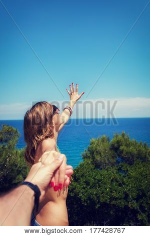 Girl holding her boyfriend and enjoying at the sea / ocean.