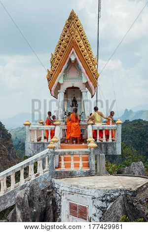 Monks At The Tiger Cave Mountain, Thailand