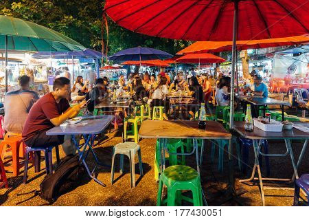 CHIANG MAI THAILAND - AUGUST 27: People eat at the street cafe on Saturday Night Market on August 27 2016 in Chiang Mai Thailand.