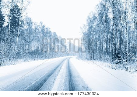 Snow-covered Open Road During A Snowstorm In Winter. Adverse Weather Conditions. Toned Filtered Photo