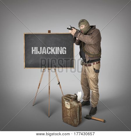 Hijacking text on blackboard with terrorist holding machine gun