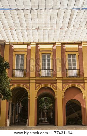 SEVILLA, SPAIN - JULY 21, 2016: Sevilla (Andalucia Spain): courtyard of historic palace near the cathedral
