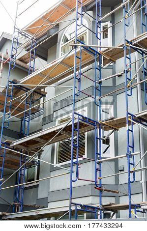Scaffolding on Wood and Stucco Condominium Building