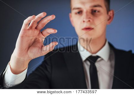 Young Businessman In A Suit Shows His Hand