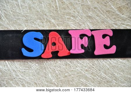 WORD SAFE ON A  ABSTRACT BCOLORFUL BACKGROUND