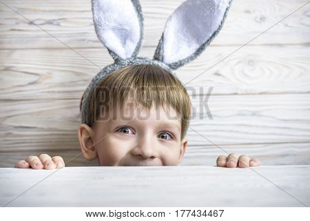 Kid With Bunny Ears Peeking From Beneath The Table - Waiting For The Easter Rabbit