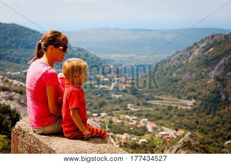 mother with kids trave in scenic mountains