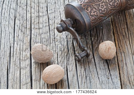 Nutmeg Whole  On Wooden Background, Selective Focus