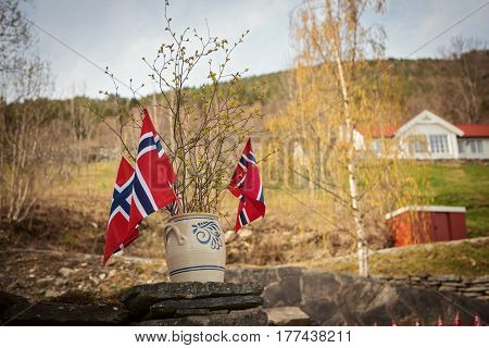 Norwegian flag with green forest landscape background. Norway symbol. Horizontal