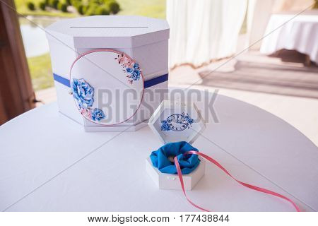 Wedding decorated mail box for greeting letters and tender white casket with coulomb