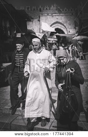 JERUSALEM, ISRAEL - MARCH 06, 2017: Arab quarter of the old city. Family of Arabs in traditional clothes