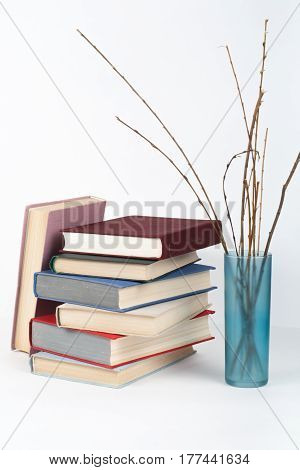 Open book hardback colorful books on wooden table white background. Back to school. Copy space for text. Education business concept