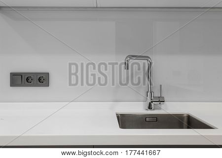 one mixer and sink in a modern kitchen