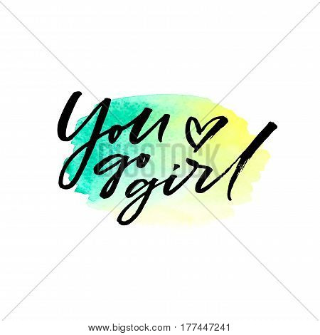 Hand drawn brush lettering You go girl on watercolor splash in green and yellow colors