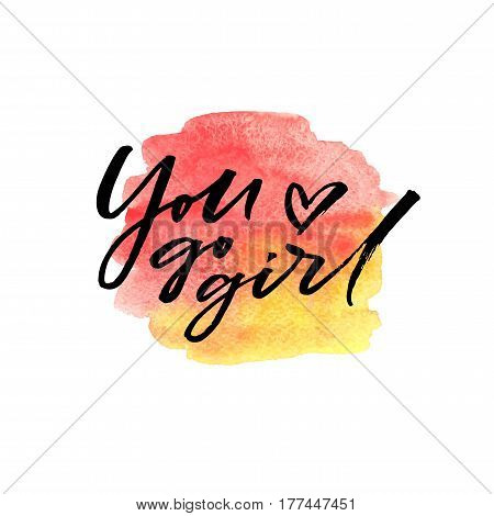 Hand drawn brush lettering You go girl on watercolor splash in red and yellow colors