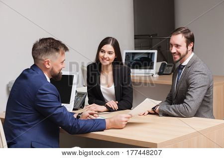 attractive young couple commits to buying and signing papers