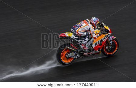 SEPANG MALAYSIA - JANUARY 30 2017 : Repsol Honda Team rider Dani Pedrosa powers his bike on the wet track during 2017 MotoGP pre-season test at the Sepang International Circuit.