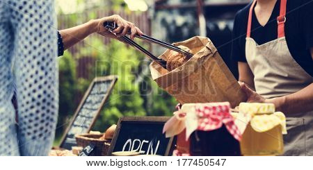 Customer Buying Croissant with Tong at Food Stall