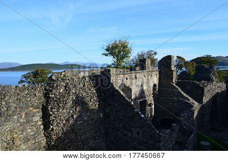 Stone rampart ruins at Dunstaffnage castle in Scotland.