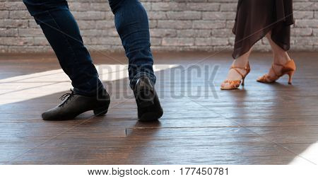 Accomplishing every dance step together. Emotional skilled capable dance couple tangoing while having training session and performing new step