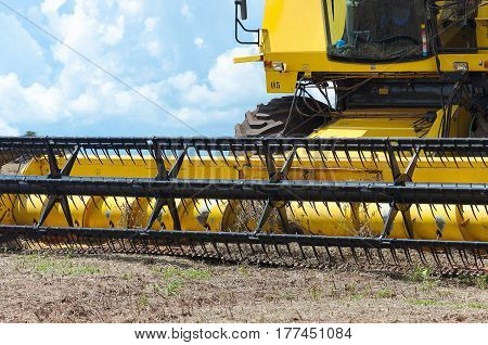 Close Up On The Blades Of A Tractor After The Harvest