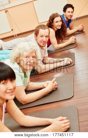 Pilates class with active senior woman at fitness center