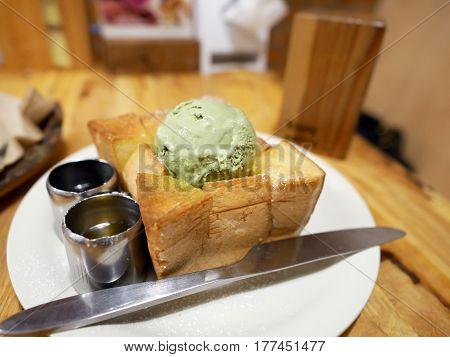 Green tea ice cream on top of honey toast