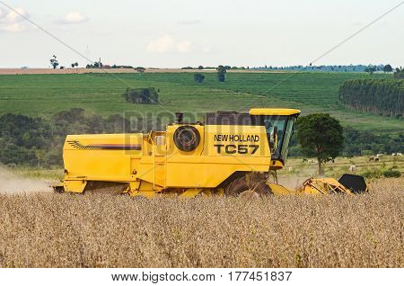 Side Of A Tractor Harvesting A Soybean Plantation