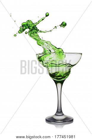 Splash In Glass Of A Green Alcoholic Cocktail Drink