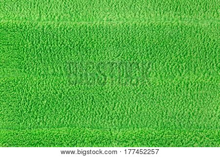 Background texture of new clean green microfiber mop floor wiper cleaning sweeping tool