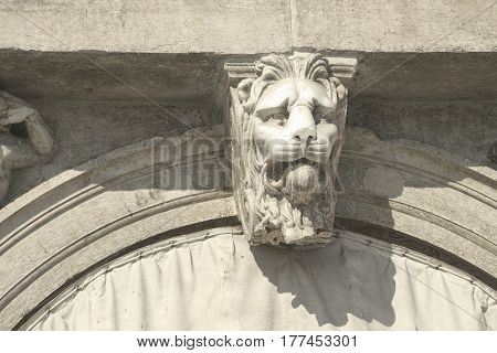building fragment with focus on lion head relief in Venice Italy