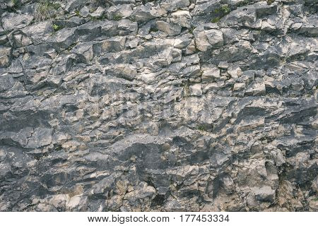 soft contrast natural background of huge slate rock formation