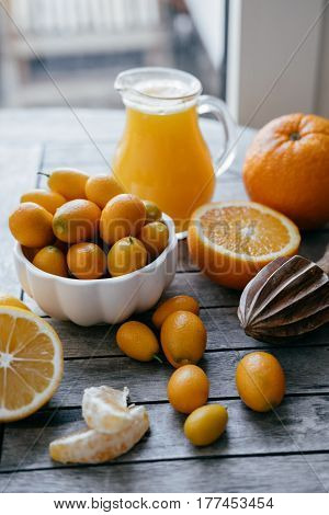 Harvest Of Citrus: Kumquat, Oranges, Lemons And Fresh Juice Squeezer On Wooden Table.
