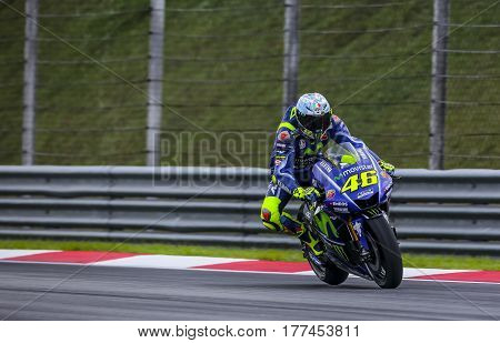 SEPANG MALAYSIA - JANUARY 30 2017 : Movistar Yamaha MotoGP rider Valentino Rossi brakes before taking a corner during 2017 MotoGP pre-season test (Winter Test) at the Sepang International Circuit.