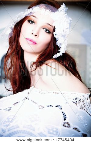 red hair woman with white parasol and white decorative lace for hair, indoor shot