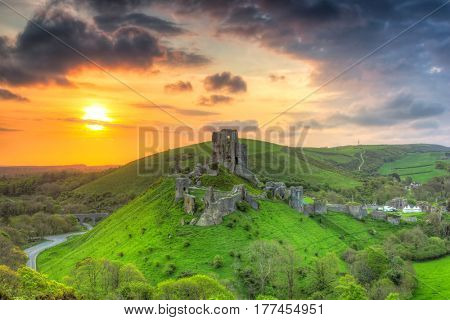 Ruins of the Corfe castle at beautiful sunrise in County Dorset, UK