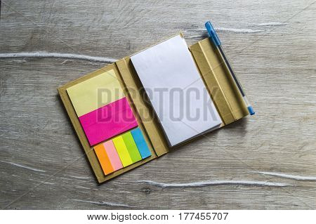 Pencil and note pad for note taking, sticky colored papers, colored sticky paper for taking notes, business man and notepad, business man and organizer,
