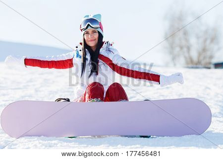 Weekend of woman with snowboard in mountains