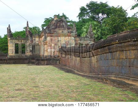 Ancient stone wall and the Gopura (doorway) of Prasat Hin Muang Tam Shrine Complex, Buriram Province in Thailand
