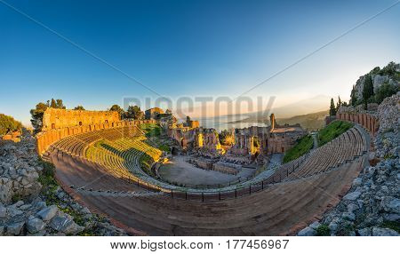 Ancient Theatre Of Taormina In The Background The Volcano Etna And The Sea Of Sicily