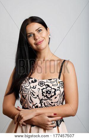 Brunette model with long hair on blank background