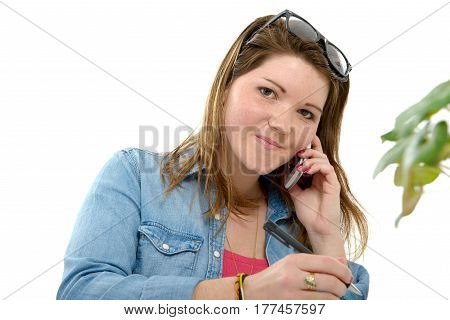 Attractive young woman with glasses using phone
